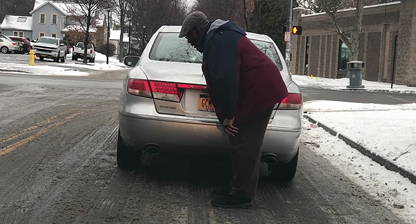 Choking driver on side of road