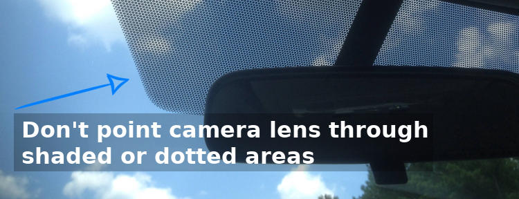 Dash Cam mounted on windshield near tint
